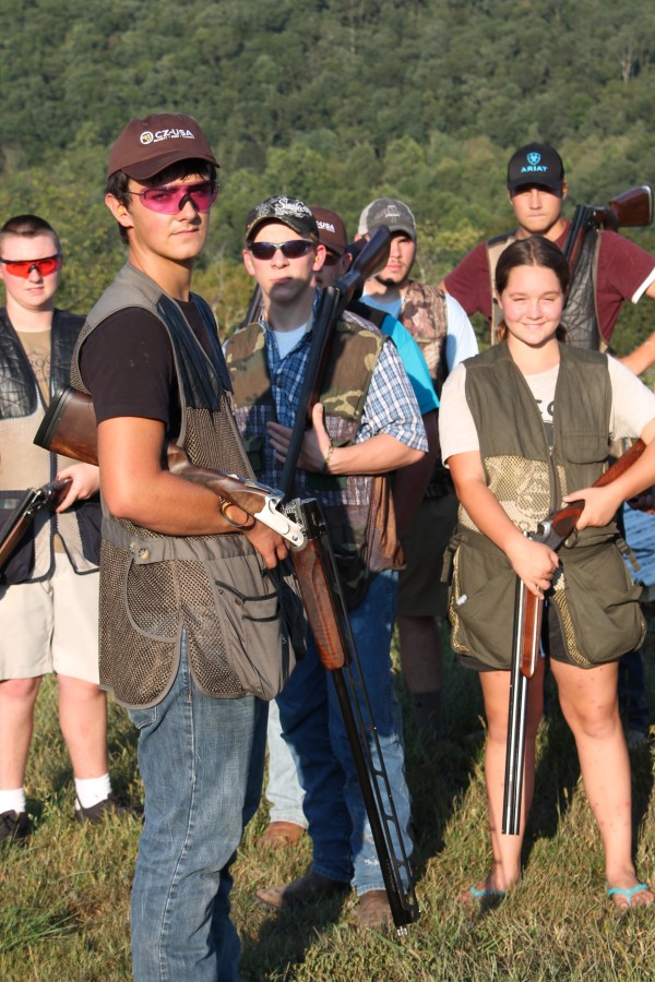 West Virginia high school student Austyn Byers (left foreground) and his fellow 4H shooters liked what they saw of CZ-USA's new All-American Trap Combo shotgun.