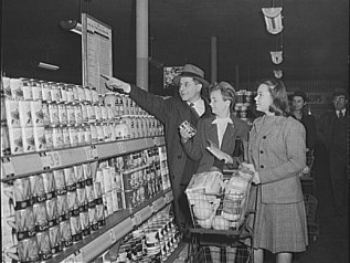 Shoppers Viewing Lists of Rationed Items, 1943.