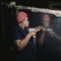 Working on a Vengeance Dive Bomber at the Vultee Nashville plant. February, 1942. Photo by Alfred Palmer. Library of Congress collections