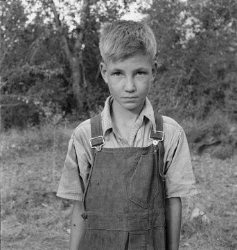 Migrant Boy Working as Hop Picker. Yakima, Washington, 1939. Photo by Dorothea Lange.