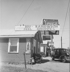 Roadside stand and filling station. Ennis, Texas. 1937. Photo by Dorothea Lange.