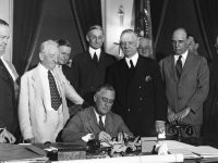 FDR signing Glass-Steagall in June 1933.