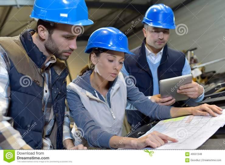 industrial-engineers-meeting-discussing-mechanical-factory-49551348