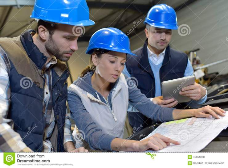industrial-engineers-meeting-discussing-mechanical-factory-49551348