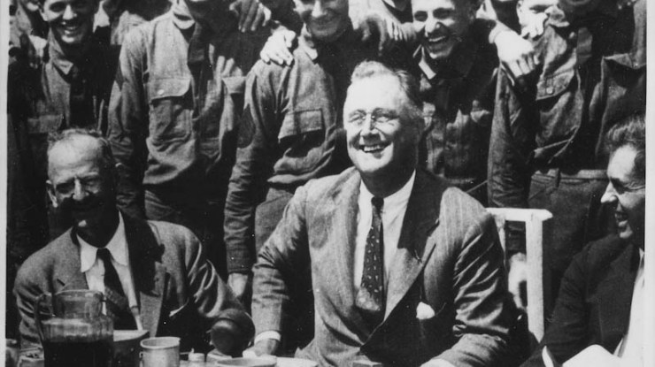 FDR joins youth at a CCC camp.