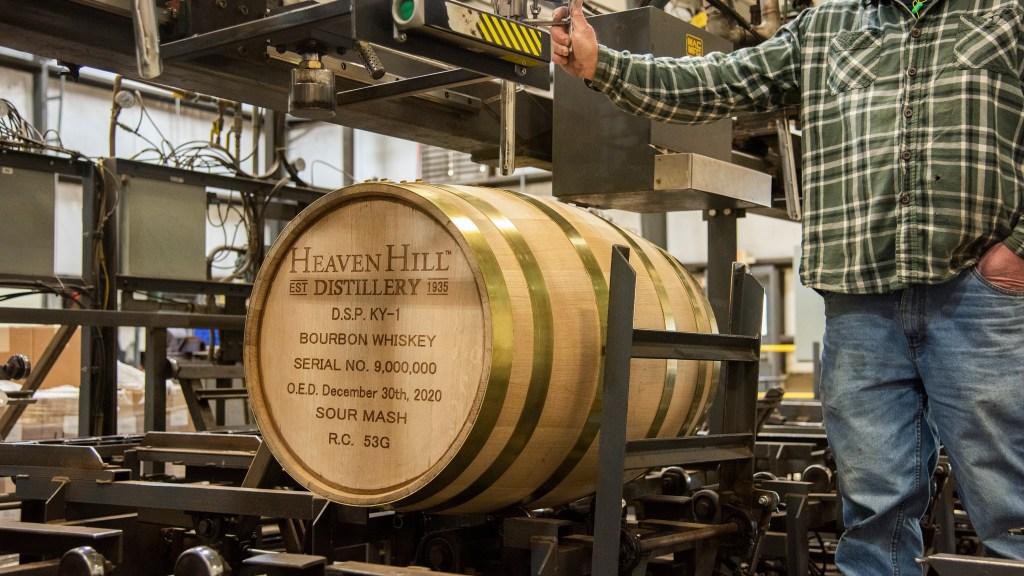 Man fills whiskey barrel with liquid