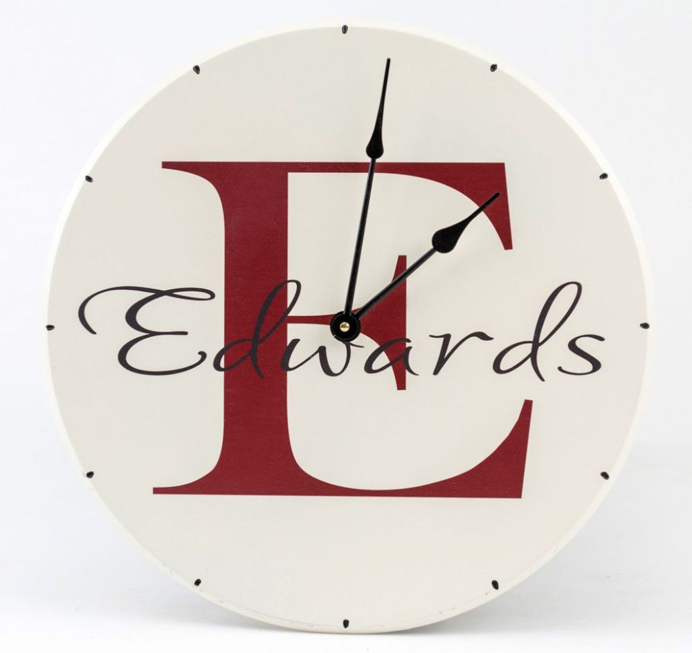 medium resolution of personalized wooden wall clock with family name and monogram with red letter name and white background