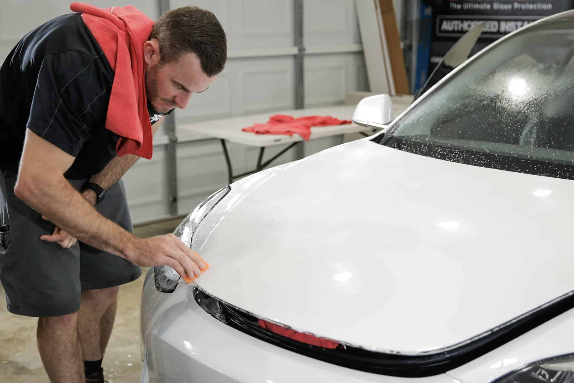World's Best Paint Protection Installer Tyler O'Hara removing badge