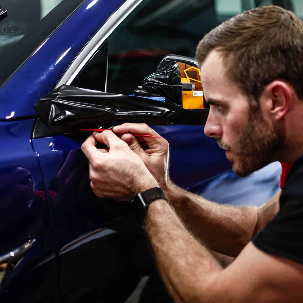 World's Best Paint Protection Installer Tyler O'Hara working diligently