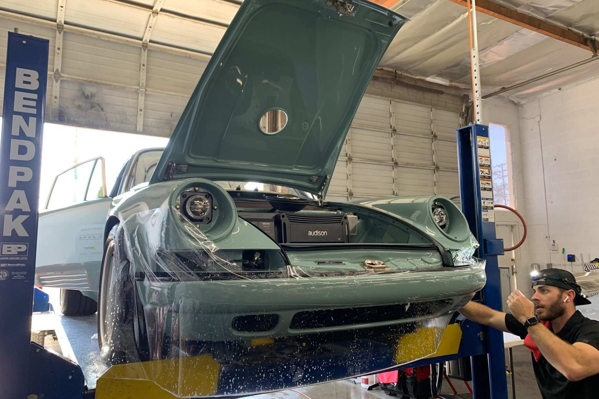World's Best Paint Protection Installer Tyler O'Hara wrapping teal car