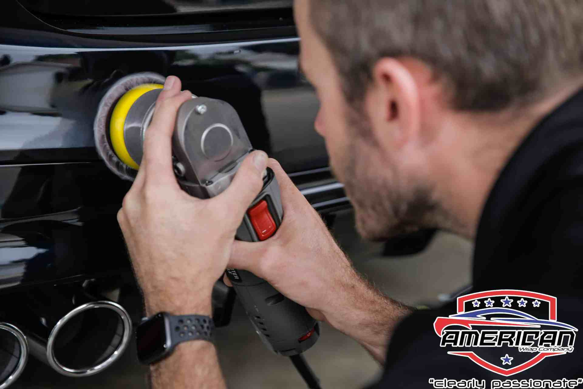World's Best Paint Protection Installer Tyler O'Hara buffing vehicle surface