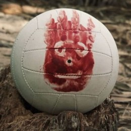Still image from Cast Away of volleyball with face painted on it in blood