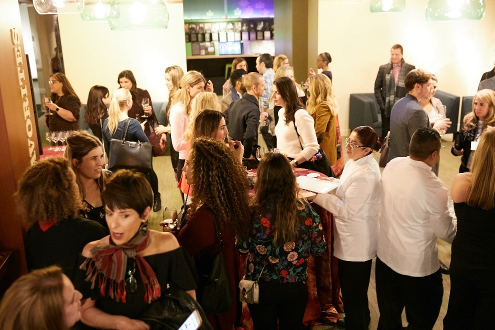 A crowd of people at a private event in the AWM's Reader's Hall
