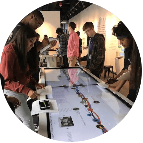 Visitors interact with touch tables at the American Writers Museum