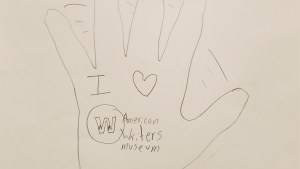 "A drawing of a waving hand with ""I love American Writers Museum"" written on the palm"