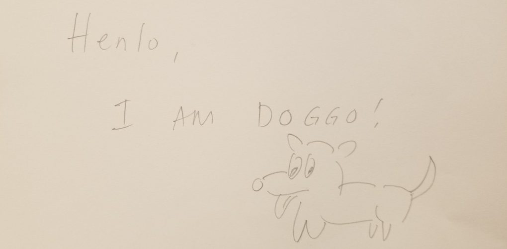 """A drawing of a dog and text that say """"Henlo, I am doggo."""" Drawn by a visitor at the Story of the Day exhibit at the American Writers Museum in Chicago, Illinois"""