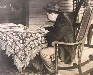 Joel Chandler Harris writes on the porch of his home