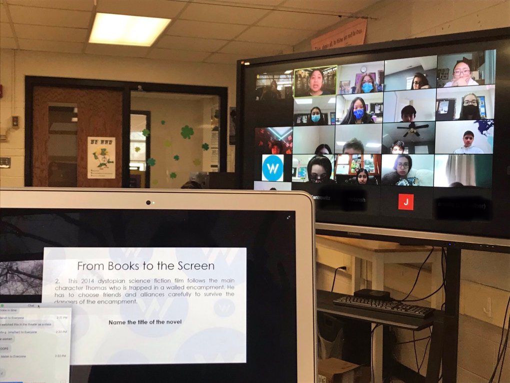 "A virtual American Writers Museum field trip. A computer screen in the foreground reads ""From Books to the Screen,"" and a TV screen in the background shows a classroom meeting on Zoom."