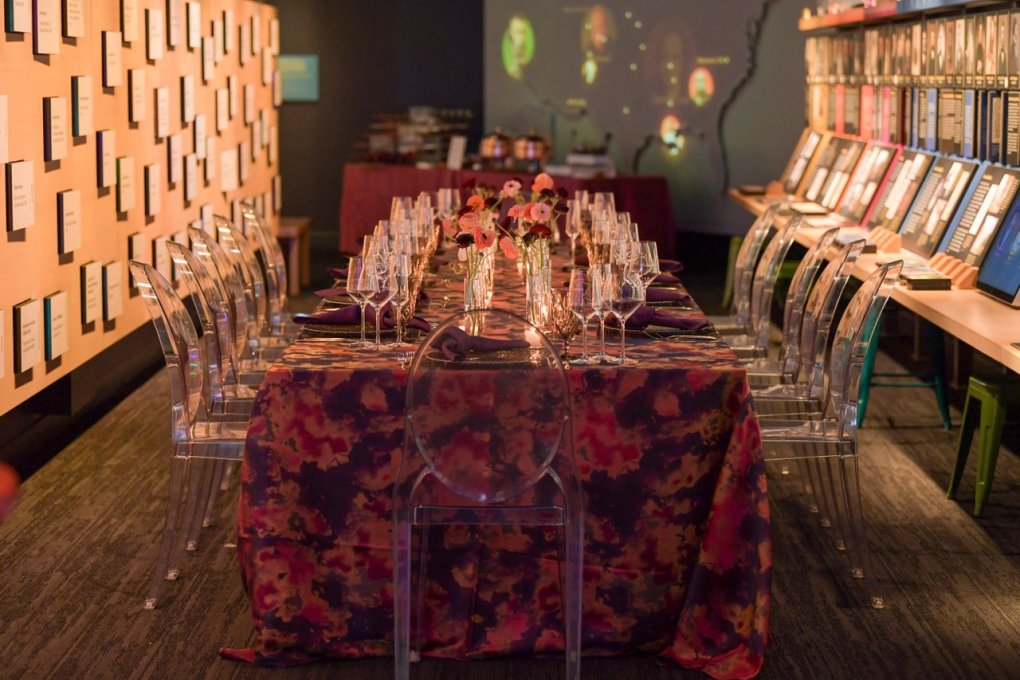 A long table set for a dinner event at the American Writers Museum in Chicago