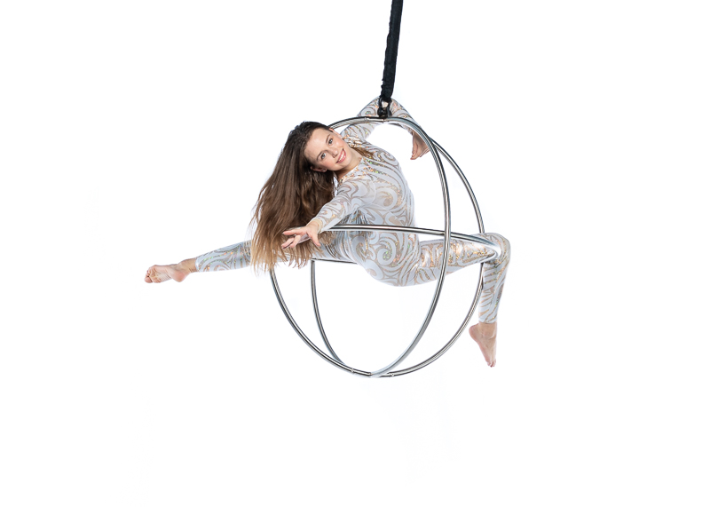 fadca youth troupe member posing in an aerial sphere