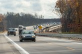 M-231 Road and Bridge project. Road opening, first cars to drive the newly opened road