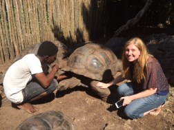 Prison Island guide Ibrahim Hammis Hamad acquaints Katrina Marks with one of the ancient tortoises who find their home there. Some of them are almost 200 years old.