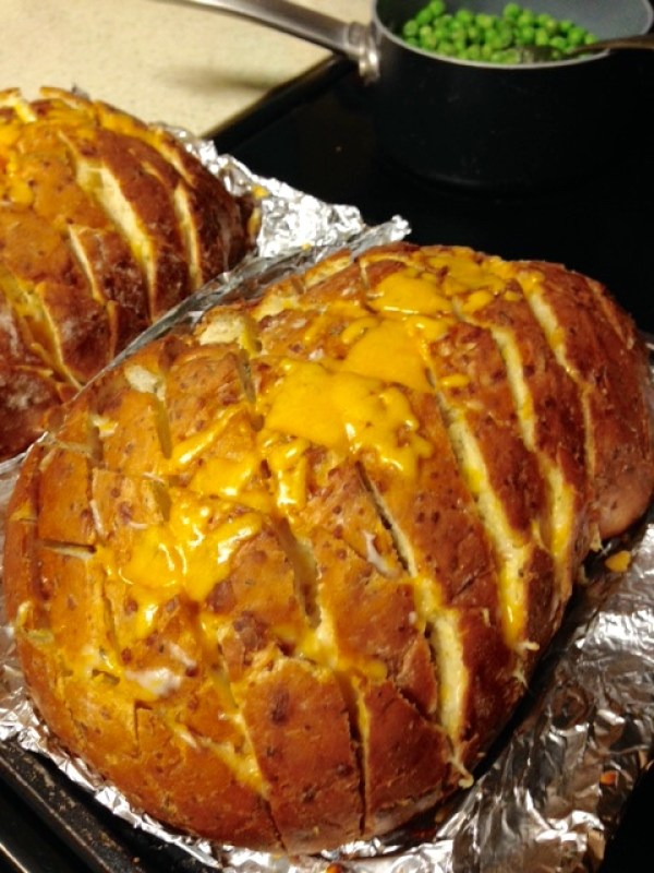 cheese and garlic pull apart bread with cheese on top
