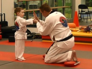 Master Amerson teaches a young student.