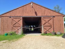 Photo of exterior of boarding stables at Amethyst Farm