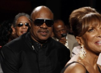 Stevie Wonder listens to Obama at the National Action Network's Keepers of the Dream Awards Gala in New York
