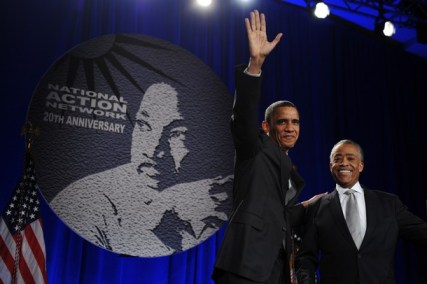 Reverend Al Sharpton stands with US Pres