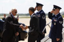 U.S. President Barack Obama is greeted by Vice President Joe Biden as he arrives to speak to troops at Fort Campbell in Kentucky