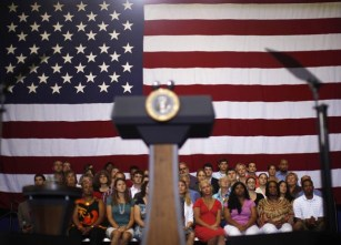 Members of the audience watch U.S. President Barack Obama participate in a town hall meeting at the University of Maryland in College Park