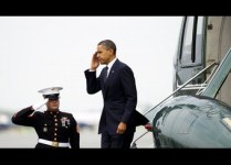 US President Barack Obama salutes as he
