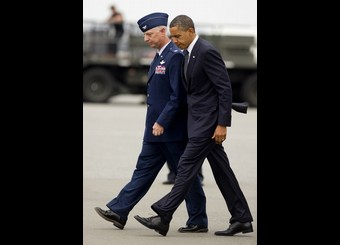US President Barack Obama walks with Col