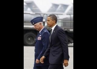 U.S. President Barack Obama walks with USAF Col. Mark Camerer, 436th Airlift Wing Commander, after he arrives at Dover Air Force Base in Delaware
