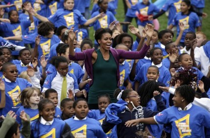 U.S. first lady Michelle Obama jumps with four hundred children at an event on the South Lawn of the White House in Washington