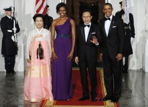 U.S. President Obama and his wife pose with South Korean President Lee and his wife at a state dinner in the White House