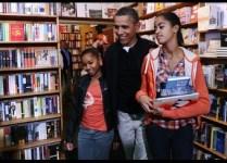 US President Barack Obama holds his daug
