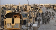 Soldiers from the 3rd Brigade, 1st Cavalry Division, prepare to depart in the last convoy from Iraq, at Camp Adder, now known as Imam Ali Base, near Nasiriyah
