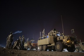 Soldiers from the 3rd Brigade Combat Team, 1st Cavalry Division prepare their Mine Resistant Ambush Protected vehicles (MRAP) before departing Camp Adder to be part of the last U.S. military convoy to leave the country near Nasiriyah, Iraq
