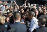 US President Barack Obama greets people