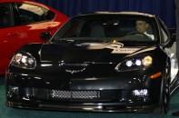 U.S. President Barack Obama sits inside car at the 2012 Washington Auto Show in Washington
