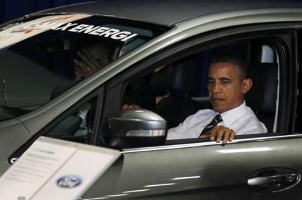 U.S. President Barack Obama sits in car at the 2012 Washington Auto Show in Washington