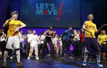 """U.S. First Lady Michelle Obama performs the Interlude dance during an event highlighting her """"Let's Move"""" initiative in Des Moines"""