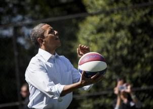 US President Barack Obama shoots a baske