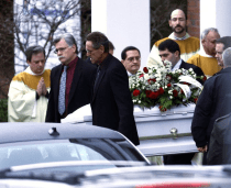 Pallbearers carry a casket out of St. Rose of Lima Roman Catholic Church after funeral services for James Mattioli, 6, Tuesday, Dec. 18, 2012