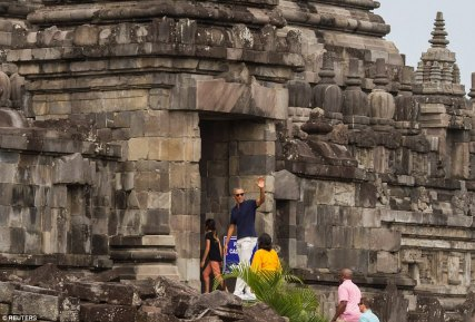 Former US President Barack Obama waves to a crowd of gathered tourists just as he enters the Prambanan Temple in Java Read more: http://www.dailymail.co.uk/news/article-4649902/Obama-waves-performs-traditional-Hindi-greeting.html#ixzz4lYIebZlj Follow us: @MailOnline on Twitter | DailyMail on Facebook