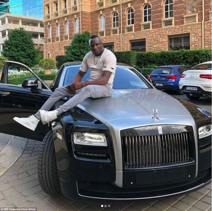 Genius Kandungure sits on top of a Rolls-Royce. The controversial businessman was able to strike his first major deal securing gas for domestic use due to his connections with Angolan Airways