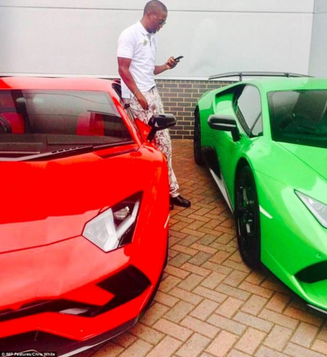 Preacher Uebert Angel poses with his cars. In Zimbabwe preachers go under the guise of 'prophets' and tour the continent